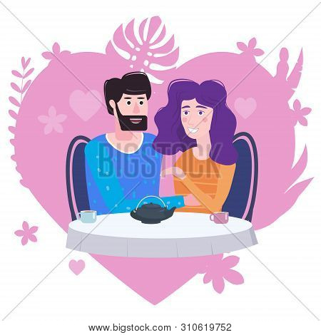 Loving Couple Is Drinking Tea In Cafe. A Man And A Woman In Love On Date Are Sitting At A Table. Lov