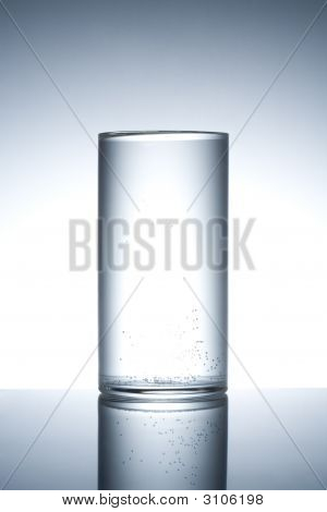 Empty Glass On A Reflecting Surface