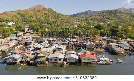 Aerial View Coron City With Slums And Poor District. Palawan.wooden Houses Near The Water.poor Neigh