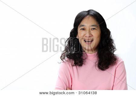 A Beautiful Mature Asian Lady Laughs Joyfully in Surprise