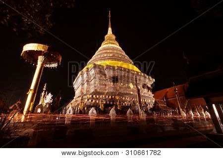 Makha Bucha Day Tradition, Walk With Lighted Candles In Hand Around A Temple With Beautiful Moon