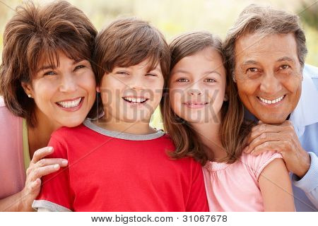 Hispanic grandparents and grandchildren outdoors