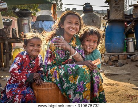Ajmer, India - February 07, 2019: Indian Children On The Street. Poor People Come With Family To The
