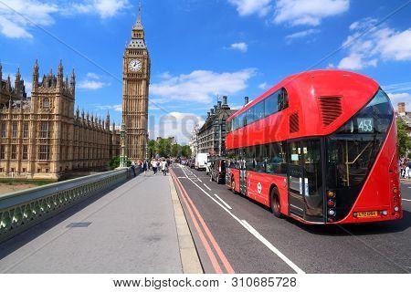London, Uk - July 7, 2016: People Walk Along Westminster Bridge Near Big Ben In London, Uk. London I