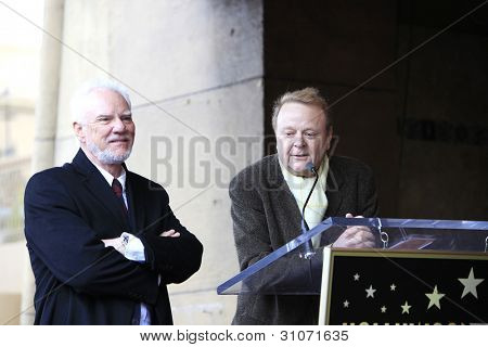 LOS ANGELES, CA - MAR 16: Malcolm McDowell, Mike Kaplan at a ceremony where Malcolm McDowell is honored with a star on the Hollywood Walk of Fame on March 16, 2012 in Los Angeles, California