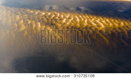 Aerial View From The Drone Of The Landscape The Mouth Of The River With Its Sandy Shoals. The Middle