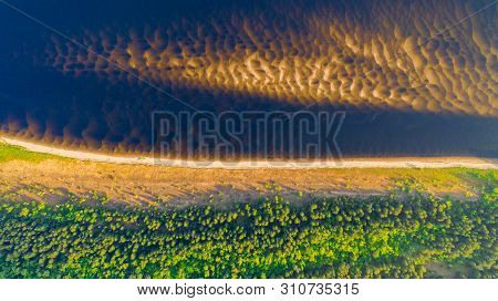 Aerial View From The Drone Of Landscape Volga River Flows Among The Hills And Fields. The Middle Ban