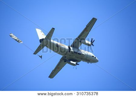 Boboc, Romania - May 22, 2019: Military Paratroopers Jump From An Alenia C-27j Spartan Military Carg