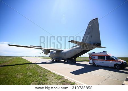 Boboc, Romania - May 22, 2019: An Ambulance Is Parked Near The Rear Exit Of An Alenia C-27j Spartan