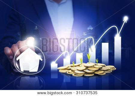 poster of Hands protecting business and security investment as real estate investment,property funds, finance concept. The growing coin mint saw a profit.  a graph that was rising with city background.