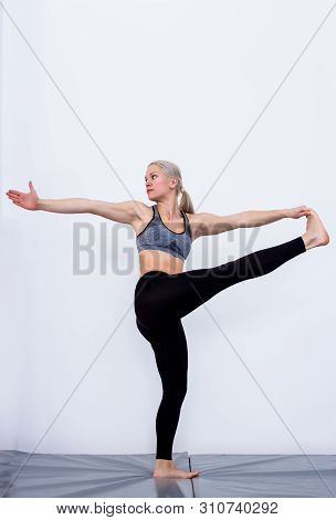Beautiful Woman Coach Yoga Practice. Yoga Concept. Extended Hand To Big Toe Variation Pose. Utthita
