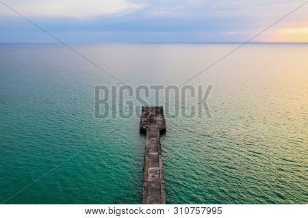 The Jetty In The Sea With The Horizontal Sea Line By Minimal Drone Photo Shooting Style In Twilight