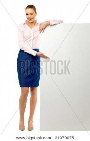 Attractive woman with blank poster