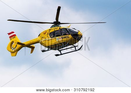 Graz, Austria - June 17 2019 : Yellow Rescue Helicopter Taking Off After Intervention. Oamtc Red Cro