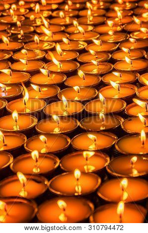 Close Up Of Tibetan Buddhist Butter Lamps Arranged Together In A Temple For Worship