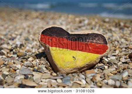 german flag on a stone heart, I love Germany