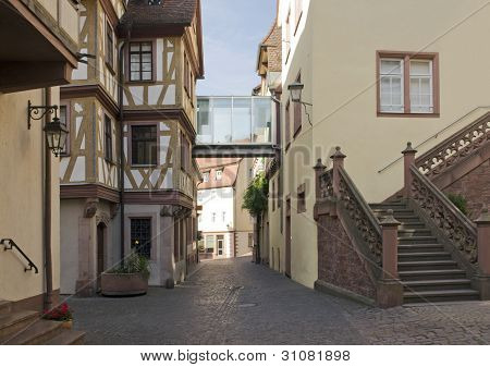 the idyllic Old Town in Wertheim am Main (Southern Germany) at evening time poster