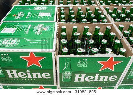 Minsk, Belarus - June 17, 2019: Glass Beer Bottles Heineken In A Boxes.  The Heineken Lager Beer Is