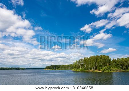 Uvodskoe Reservoir With Green Wooded Shores And Beautiful Cloudy Sky, Russia.