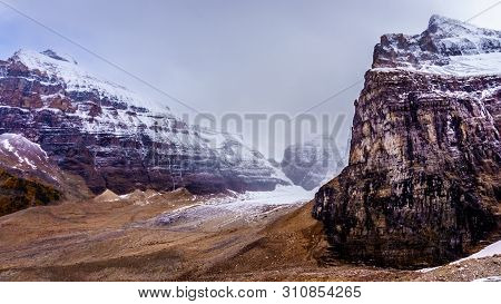 View Of Peaks In The Rocky Mountains At The Plain Of Six Glaciers Near The Victoria Glacier. Viewed