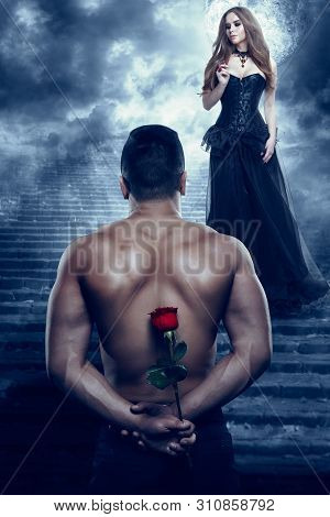 Romantic Couple, Man Give Flower To Beautiful Woman, Sexy Lover Athletic Holding Rose And Looking To