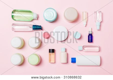 Group of plastic bodycare bottle Flat lay composition with cosmetic products on pink background empty space for you design. Set of White Cosmetic containers, top view with copy space poster