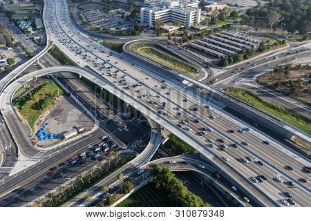 Aerial view of cars, ramps and buildings near the San Diego 405 Freeway at Wilshire Bl in Los Angeles, California.