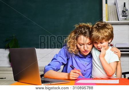 Mathematics For Kids. Nice Family Photo Of Little Boy And His Mother. Back To School. Family Day. Fa