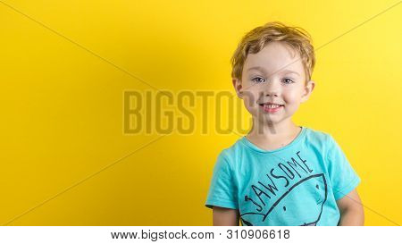 Adorable Small Three Years Old Boy With Cute Face Expression On Yellow Background