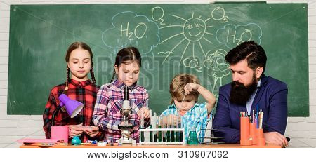 Science involves theory. School chemistry experiment. Explaining chemistry to kids. Fascinating chemistry lesson. Man bearded teacher and pupils with test tubes in classroom. School chemistry lab poster