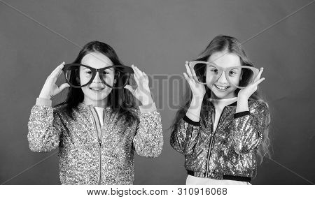 Glamorous Little Clubbers. Small Kids In Party Glasses Having Fun. Cool Party Girls Wearing Fancy Gl
