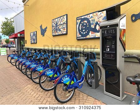 Fruitvale, Ca - June 26, 2019: Blue Go Ford Shared Bikes Lined Up In The At Fruitvale Bart Station W