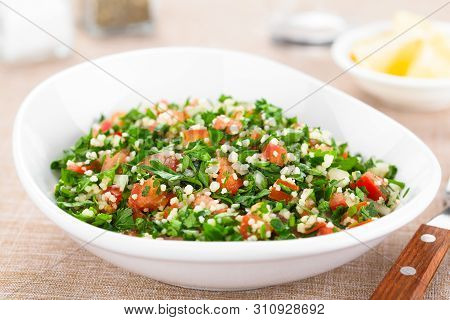 Fresh Vegan Tabbouleh Salad Made Of Tomato, Parsley, Onion And Couscous In Bowl (selective Focus, Fo