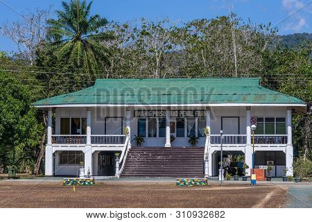 Puerto Princesa, Palawan, Philippines - March 3, 2019: Iwahig Penal Colony. Two Story White Office B