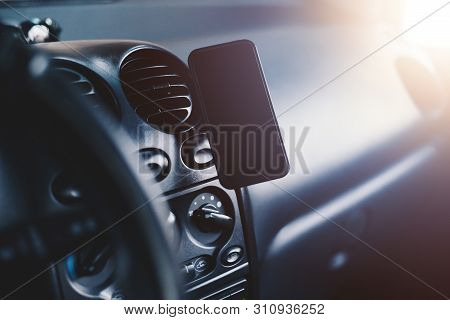 Automobile Interior View With A Mobile Phone Mounted On Magnetic Car Mount Holder