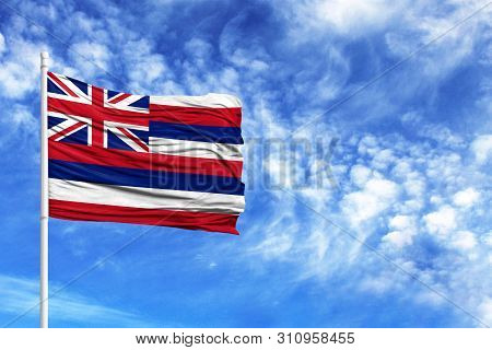 National Flag State Of Hawaii On A Flagpole In Front Of Blue Sky