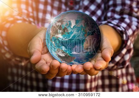 Earth Was Holding In Human Hands On Farmer Background. World Environment Day And Green Earth Or Eart