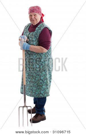 Active Elderly Woman Holding Pitchfork