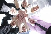 business people group joining hands and representing concept of friendship and teamwork,  low angle view poster