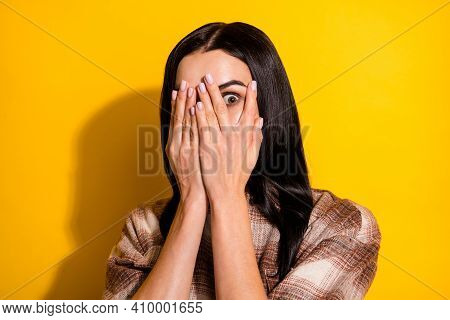 Photo Of Young Woman Cover Face Hands Hide Look Afraid Scared Horrified Isolated Over Yellow Color B
