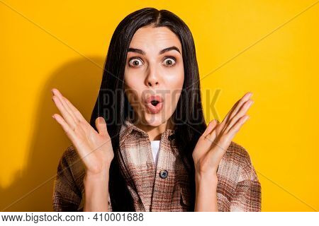 Photo Of Young Woman Amazed Shocked Surprised Fake Novelty News Wow Isolated Over Yellow Color Backg