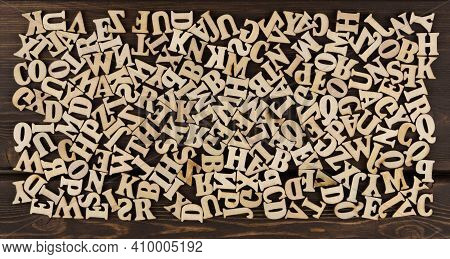 Background Is Made Of Wooden Jumbled Letters. English Alphabet.  Vintage Letterpress Types. English
