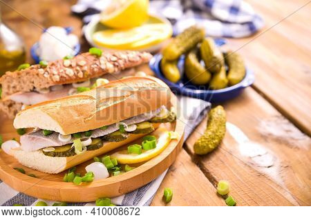 Dutch Herring In A Sandwich. Toast With Dutch Herring, Onions, Pickles. Traditional Rustic Appetizer