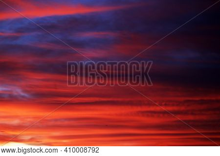 Blurry Background Of Red Blue Sunset Sky. Dramatic Sky With Colorful Cloud Background. Red Burning S