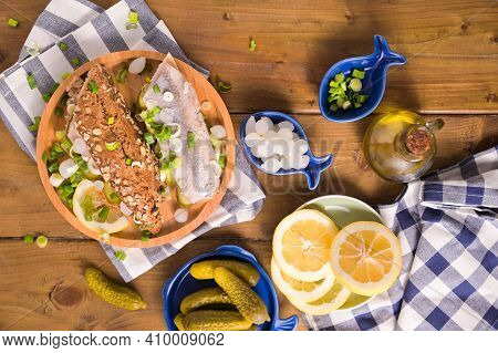 Dutch Herring In A Sandwich In Cereal Bread And A White Bun. Toast With Dutch Herring, Onions, Pickl
