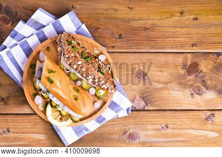 Dutch Herring In A Sandwich In Cereal Bread On A Wooden Background From Above. Toast With Dutch Herr