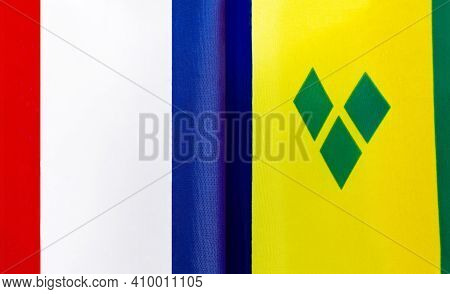 Fragments Of The National Flags Of France And Saint Vincent And The Grenadines Close-up