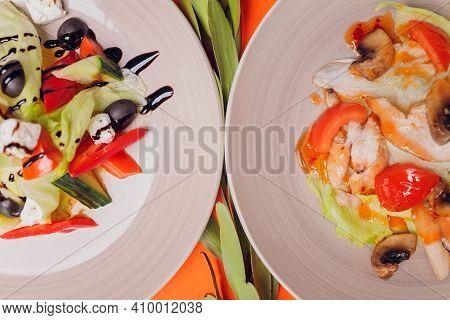 Set Of Salads On A Dark Background. Greek Salad, Caesar Salad, Vegetable Salad.