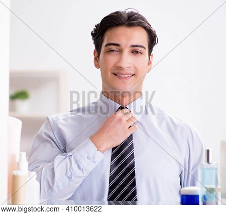 Man is getting dressed up for work in bathroom
