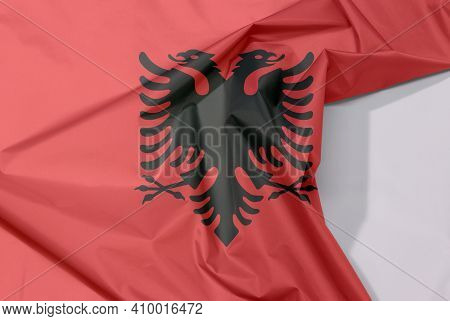 Albania Fabric Flag Crepe And Crease With White Space, A Red Field With The Black Double-headed Eagl